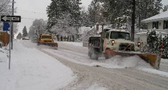 Snow trucks clearing the roads after a snow storm